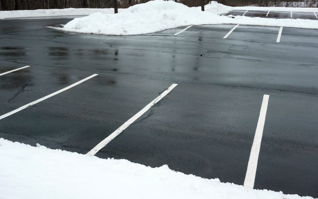 Parking lot cleanup efforts after snowfall
